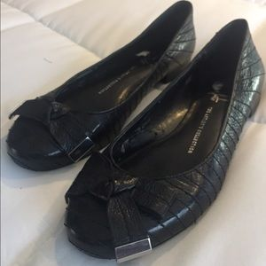 Black leather ballet flats with bow details